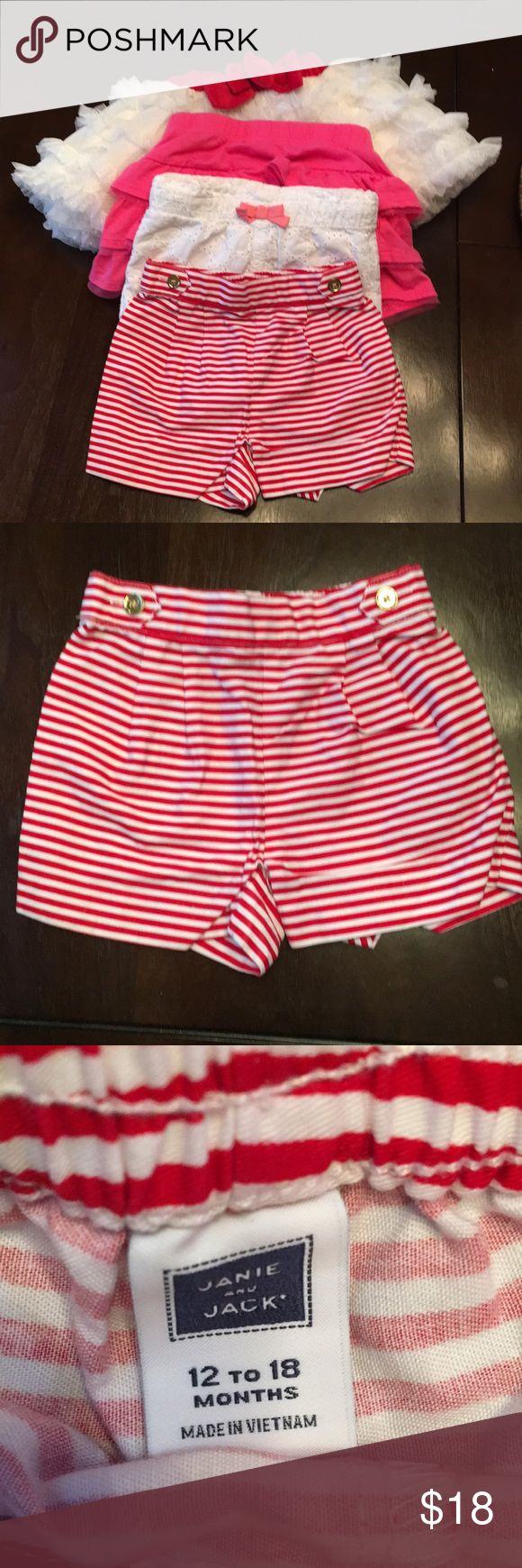 Bundle of 4 shorts/skirts 12-18 mths Janie & jack Janie and Jack red/white striped shorts. Size 12-18 months. White Cherokee shorts size 12 months. Pink layered garanimals shirt size 12 months. Disneystore brand ruffle white and gold glitter skirt. Size 12-18 months. All items in excellent condition, only worn one time! Janie and Jack Bottoms