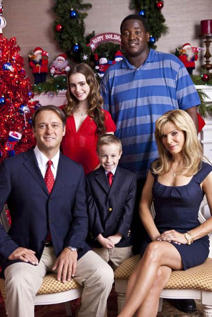 Well Ive had a few cold ones sooo I'm just gonna say it..... Did you know theres a colored by in your Christmas card?    Sandra Bullock  Tim McGraw  Quinton Aaron and the cast as The Touhys  in  The Blind Side