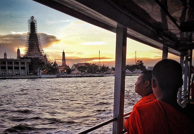 Two monks and the temple. #monks #buddhist #buddhisttemple #temple #wataruntemple #watarun #chaophraya #river #boat #sunset #bangkok #thailand #wanderlust #instatravel