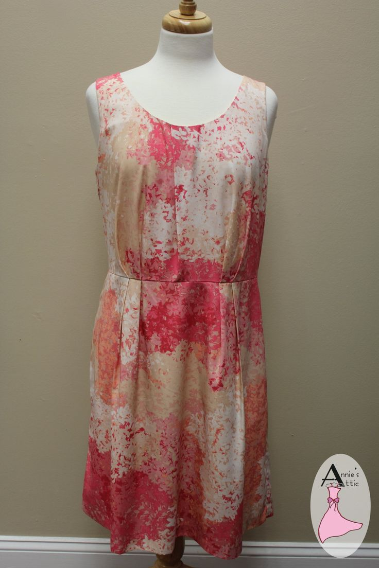 Ann Taylor LOFT peach and pink floral dreamy dress! Ann Taylor LOFT pink and peach floral dress, 12 Zips up the back, v-neck Soft pleats from the waist - front only http://stores.myresaleweb.com/annies-attic/item/ann-taylor-loft?id=33455