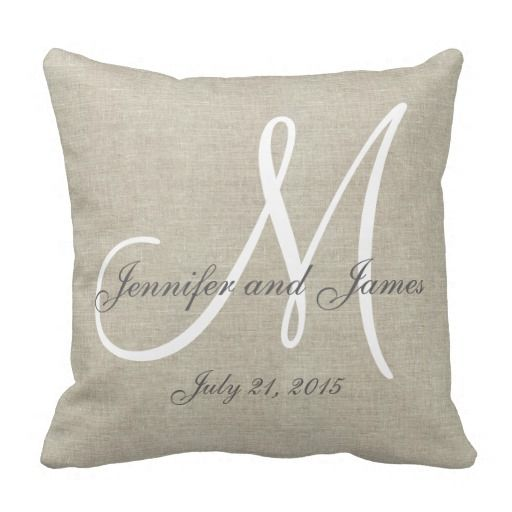 Personalized beige, gray and white monogrammed pillow with bride and groom names and wedding date in a script font overlay design on a PRINTED beige linen photo effect background. Elke Clarke© for MonogramGallery at Zazzle. Makes a great gift for newly weds. Great trendy, elegant accessory for your bedroom, favorite chair, as fun home decor in your family room or formal decorative addition to your living room. Customize with your names, monogram initial and wedding date.