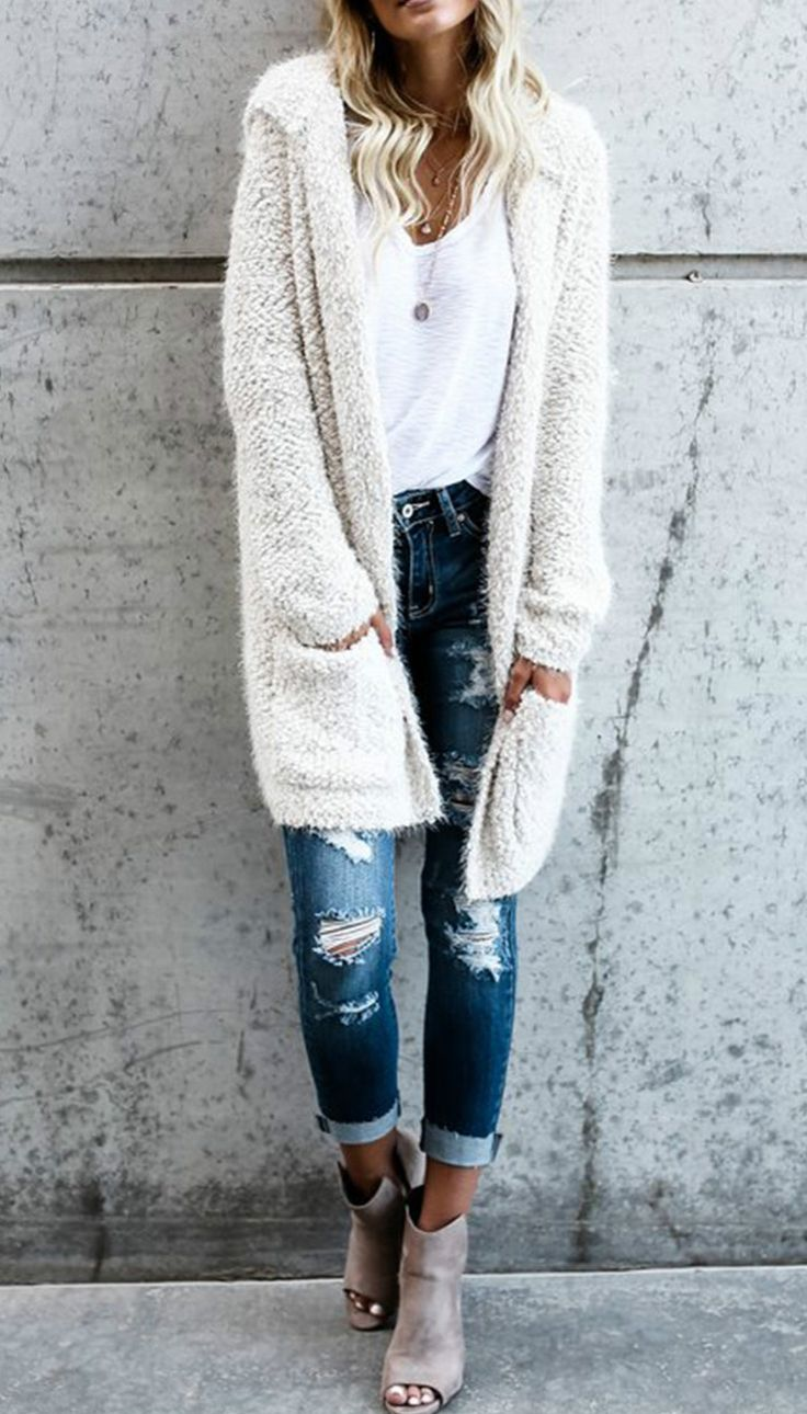 love the texture and length of this jacket, Not sure what the color is--do not want white or black anything ever!