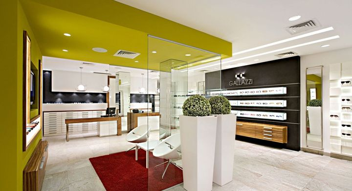 The project solves optimally the study of pathways succeeding in directing instinctively the customers in a dynamic exhibition pathway oriented in depth and enhanced in the ceiling by two bright lines that function as elegant signs towards the assisted sales counters