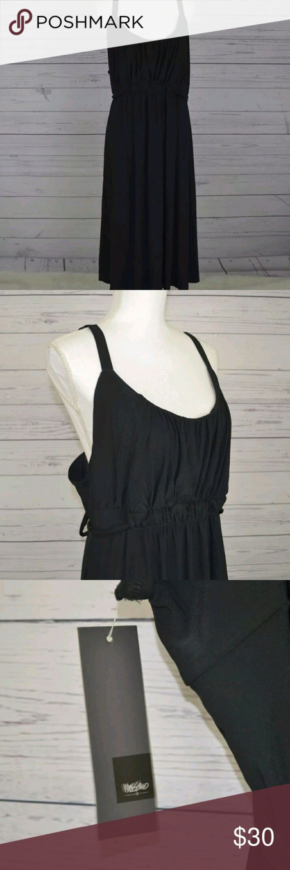 """Mossimo  Women's black dress plus size 28W 30w Brand: Mossimo  Condition: New with tag  Color: Black Ebony  Materials: 95% Polyester, 5% Spandex  Origin: United Arab Emirates  Size:28W/30W   Measurements:  Chest (Armpit to armpit): 26""""  Length (Shoulder to hem): 51"""" (plus or minus with adjustable strap)   *Measurements are all approximate.   Note: Colors and or hues may different due to monitors, computer and or device used to view this item.  This item is shipped from a smoke-free home…"""