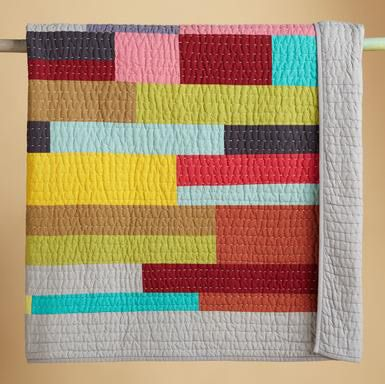 Love the solid color blocks and the hand quilting! picture