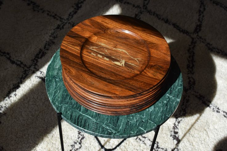 Set of 9 Danish mid century rosewood plates/ wall platters with Sterling silver inlays depicting Greenlandic motives. Design by Robert Dalgas lassen. These plat