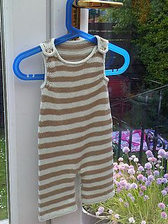 Cute stripey dungarees, knit in easy-to-wash cotton for a cool summer outfit (or substitute the cotton yarn for wool for a cosier set for winter). These are roomy enough for cloth nappies, with poppered legs for easy nappy changes. A folded hem and i-cord edging gives it a neat finish.
