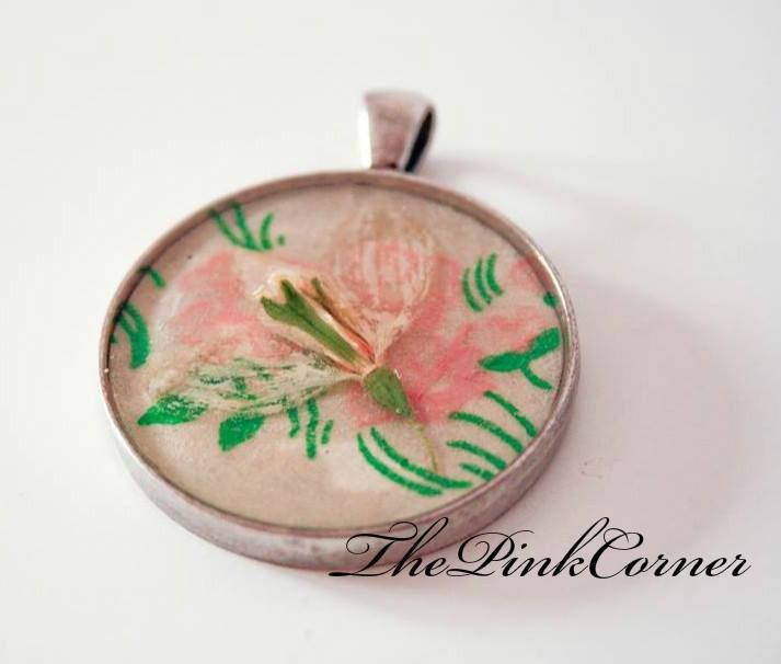 Real flower fixed in crystal clear resin  Silver pendant
