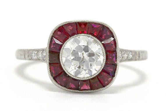 The Rancho Palos Verdes Vintage Engagement Ring. Often called a target ring, you will hit the bulls eye when you present this antique bauble to her. Handmade of enduring platinum and held within a low, bezel-setting circled with delicate millegrain beading is a crisp and brilliant
