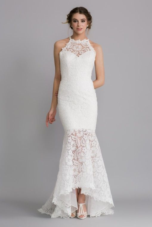 OCA629T SYLVIA  This gown embraces the new style guipure lace , figure hugging with a mermaid skirt, a modern halter neckline and open tie back detail.