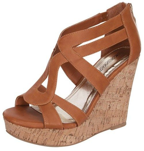 We love these Paola Wedges and you will too! Cognac faux leather material, open toe, and a 4 1/2 inch wedge finishes your new favorite wedges!
