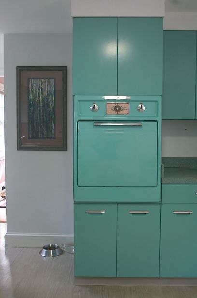 Midcentury vintage retro green kitchen.  We had a G.E. kitchen with all metal cabinets in milk chocolate brown.  The neighbors had kitchens in pink & turquoise.