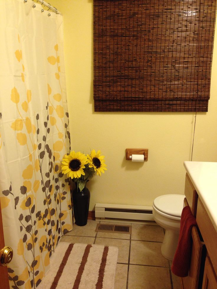 already have a yellow shower curtain floor mat and brown towels maybe sunflowers