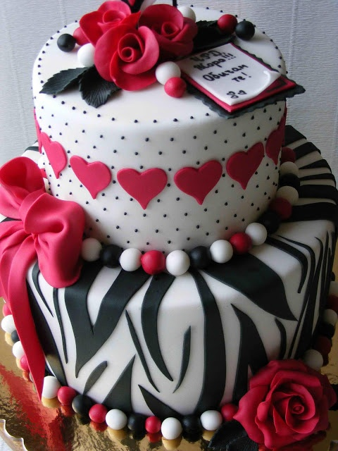 Zebra striped, pink hearts, dots, little balls on tiered cake This would be cool for my niece on her birthday.