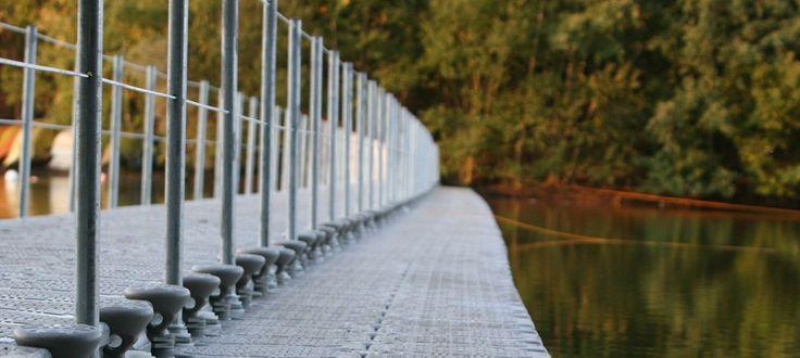 Pontoon walkway across a lake.