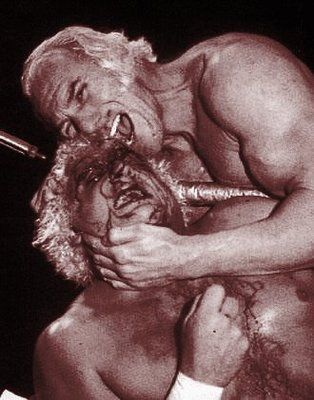 superstar billy graham takes a bite out of dusty rhodes