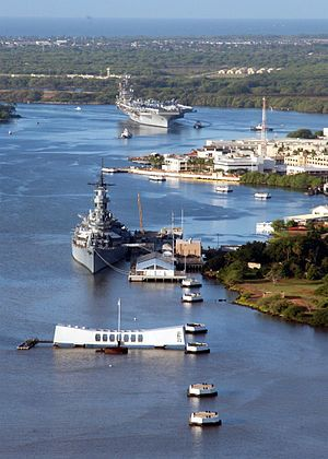 Pearl Harbor; Arizona Memorial, USS Missouri Memorial and Aircraft Carrier entering the harbor.