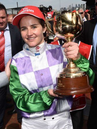 Michelle Payne holds the 2015 Melbourne Cup. First female Jockey to win the Melbourne Cup.