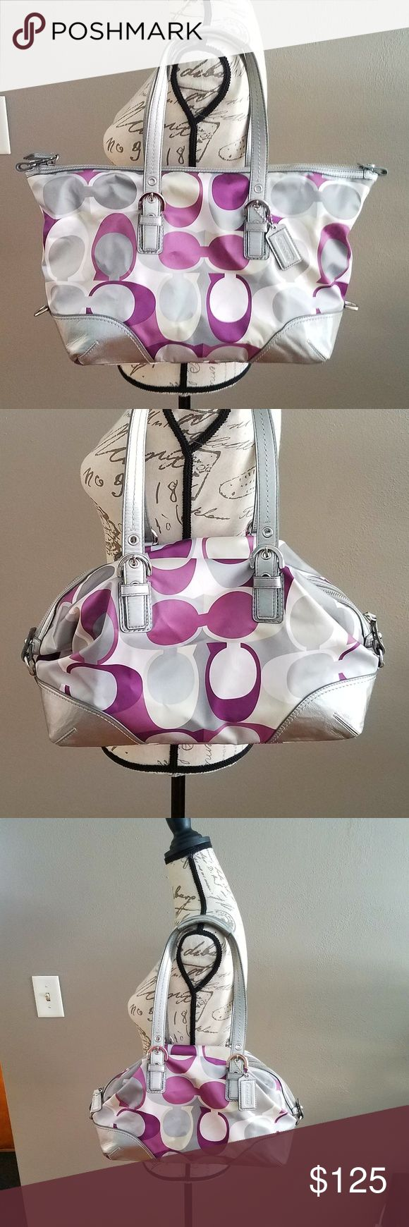 """COACH Purple Tote/Satchel Soho Purse Zip-top closure, water-resistant fabric, polished silver-tone hardware, silver leather trim, silver leather coach hangtag. Interior: 2 slip pockets and 1 large zippered pocket, fully lined w/ lavender sateen fabric. The sides have clips that can convert the satchel into a larger tote. Tote : 18""""(L) x 11""""(H) x 4.5"""" (W) Satchel : 16""""(L) x 9""""(H) x 4.5""""(W) Straps are in great condition. There are a couple small brown spots shown in the pictures...but as you…"""