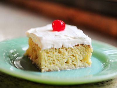 Tres Leches Cake- For the icing add; 1 t non flavored gelatin, 2 T Water-Mix together.  Heat in microwave, cool.  Slowly add to whipping cream when it starts to thicken.  Keeps frosting from turning back to milk.