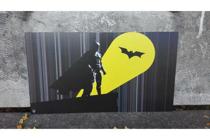 This cinemagraph depicts batman and the bat signal from the 2008 film, The Dark Knight, with the colours of the movie in the background.