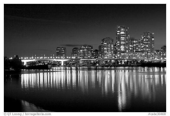 black and white  Skyline seen across False Creek at night. Vancouver, British…