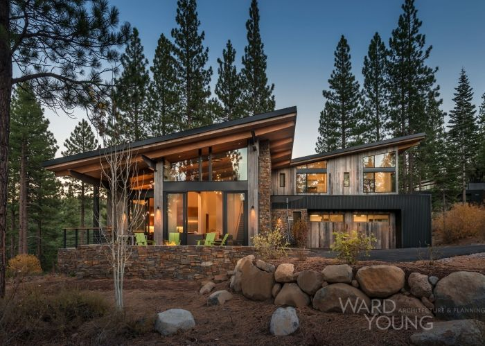 A 3,500 sf home with a 2+ car garage. Complete with 4 bedrooms, a media room, and an inviting ski lift chairhung at the entry. For a low maintenance exterior, the team chose vertical barn wood, painted corrugated metal, and ledge stone for finish materials. Architecture: Ted Brobst & Caitlin Davis
