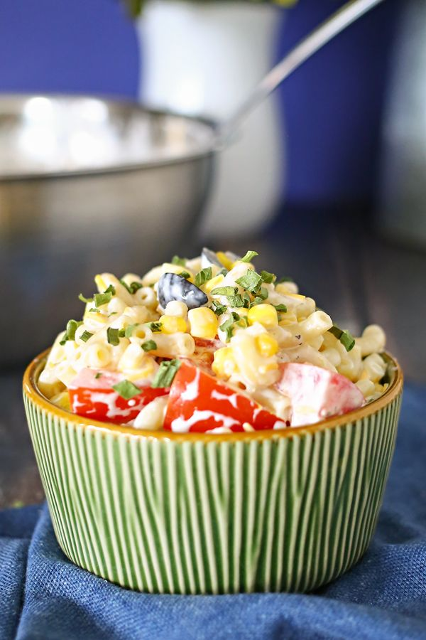 Summer Macaroni Salad — I added olives, corn, tomatoes & cheddar cheese to my pasta & seasonings. Grilled chicken, black beans, or chopped peppers would be great mix-ins as well. This makes a fabulous addition to any backyard barbecue party. We have brought it to many a church potluck & it's one of the first bowls to empty out!