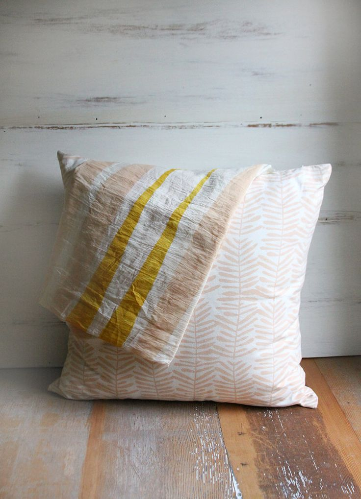 Handmade in India, these block-printed textiles are available in scarves, pillows, and table linens, all made in hand drawn, graphic, designs.