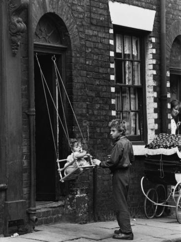 © Shirley Baker  Baby in a Doorway Swing - Salford, 1964