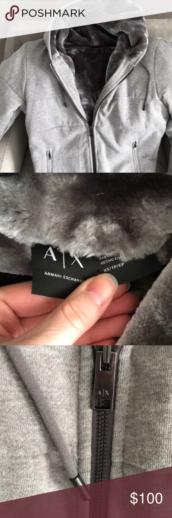 NWOT Armani Exchange Faux Fur Lined Hoodie Super cozy faux fur lined hoodie in new condition. Outside is a light gray with the fur lining a darker gray. This hoodie is in excellent condition and was only worn once. It's just a little too big on me. Armani Exchange Sweaters