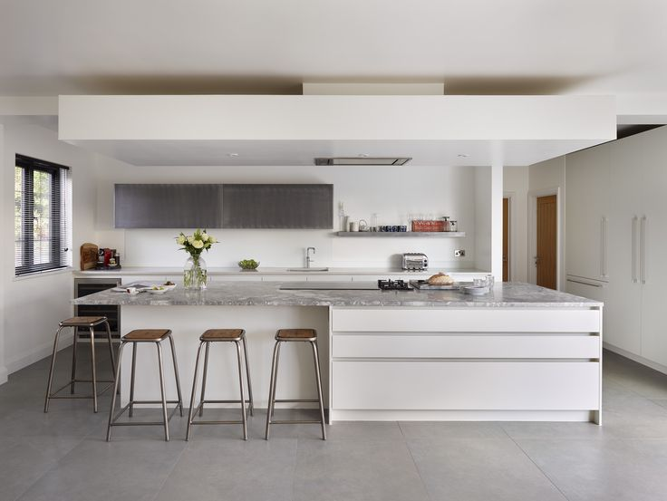 Roundhouse Urbo bespoke kitchen with cabinets in Patinated Silver