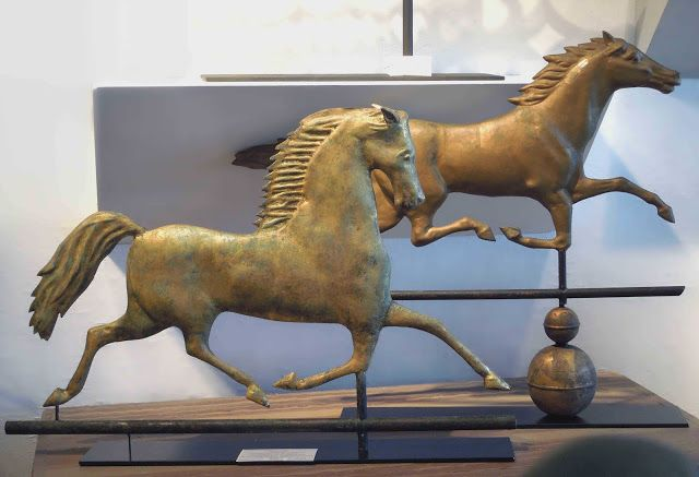 Tone on Tone: Collecting and Displaying Weather Vanes Blackhawk and Smuggler Running Horse displayed on a desk