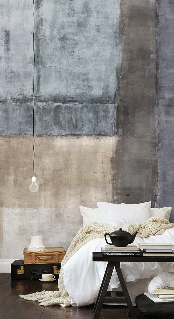 big industrial wall, cozy fluffy white bed