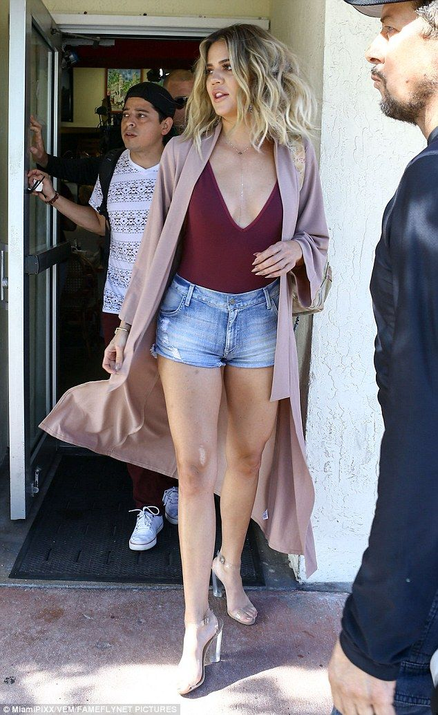Sisters in style: Khloe Kardashian looked amazing in minuscule shorts and a low-cut bodysuit as she stepped out in Miami on Wednesday