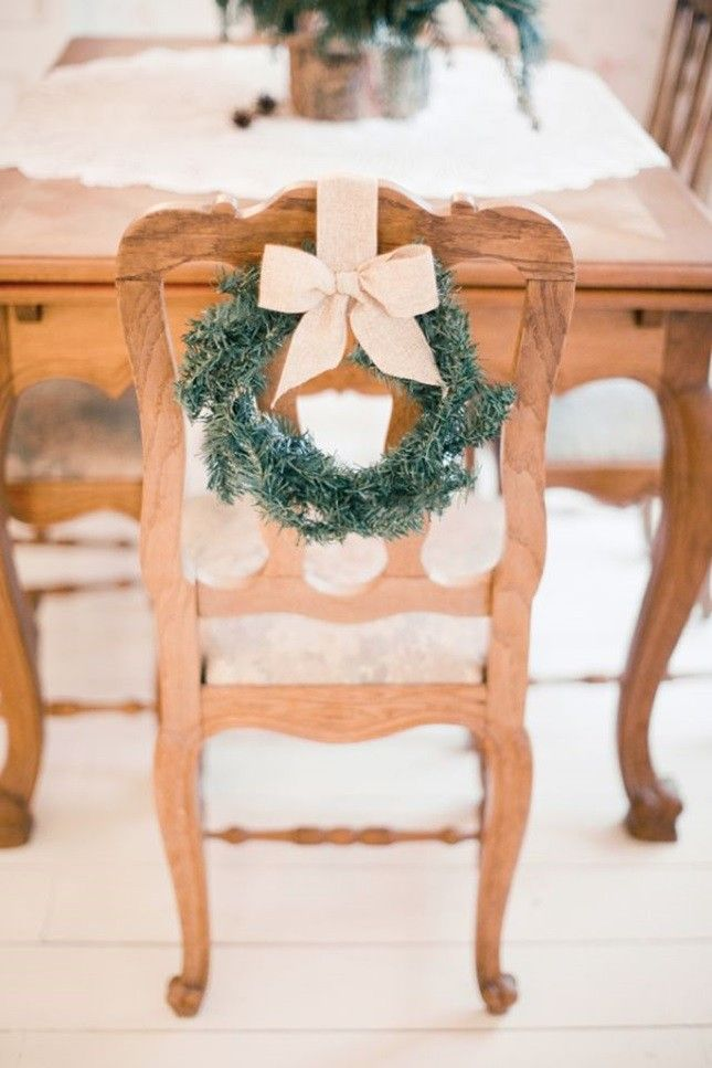 Add mini evergreen wreaths to chairs to complete your winter wedding decor.