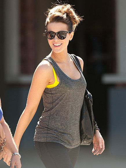 Star Tracks: Thursday, July 24, 2014 | AFTERNOON DELIGHT | Kate Beckinsale steps out in the perfect summer look – casually piled-high hair, sunnies, colorful bra peeking out from a tank – as she makes her way around L.A. on Wednesday.