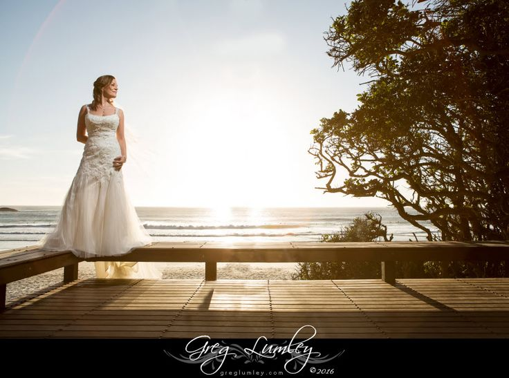 Bride posing at a beach wedding in Cape Town by Greg Lumley