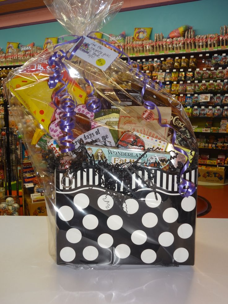 """""""For The Naughty Girl In Your Life"""" You know she deserves only the best, and we're letting you know that this gift basket is definitely the best. It's filled to the brim with delectable delicacies, as well as some items sure to get some chuckles and smiles out of that lucky lady!"""