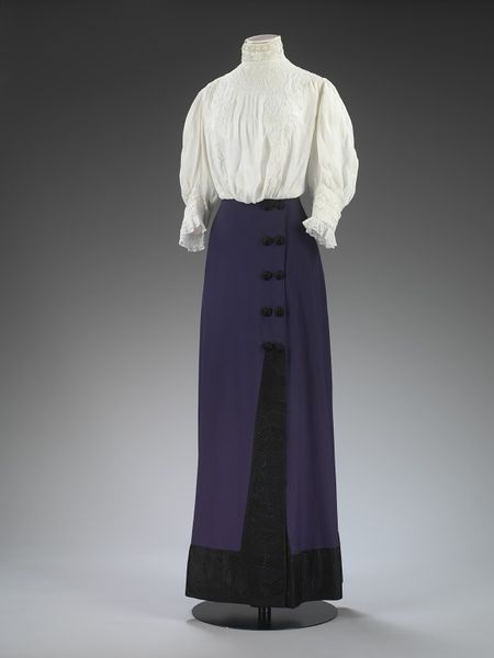 1912 Skirt (has matching coat not pictured) Place of origin:London, England (made) Date:ca. 1912 (made) Artist/Maker:Mascotte (maker) Materials and Techniques:Wool gabardine, lined with silk satin, trimmed with Jacquard-woven silk, metal Museum number:T.43&A-1960 Gallery location:Fashion, room 40, case CA6 V&A