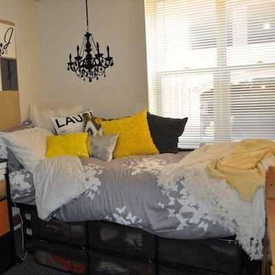 a very bold and modern yellow and grey college dorm room