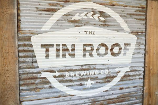 Love this sign painted on corrugated metal.