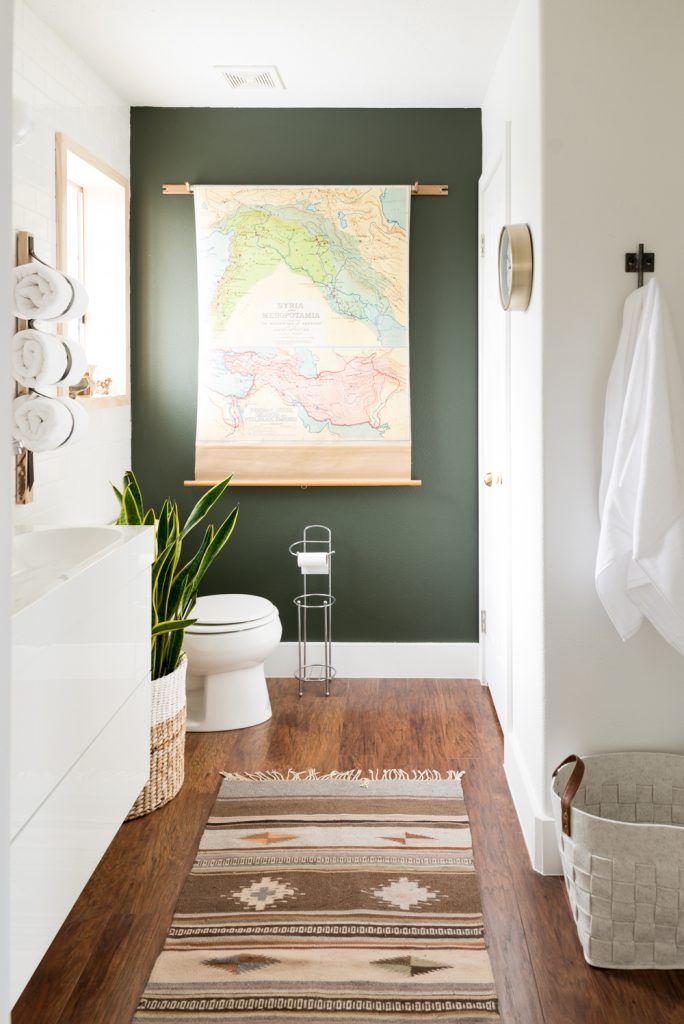 Love how they use the map on the green wall. // Mind-blowing $939 Bathroom Makeover