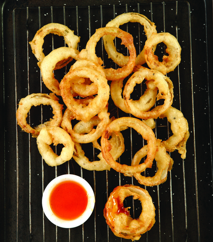 A casual comment by a friend just days before the photo shoot about a restaurant in Calgary that serves their onion rings with honey… . We thought spicy honey would be even better! Sriracha and honey make these onion rings over-the-top delicious!
