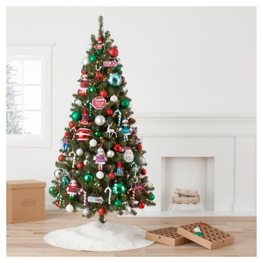 Decorate your tree with all the Christmas staples that feature a big boost of fun, bright colors with this Winter prk Tree Ornament Kit from Wondershop. This fun Christmas ornament kit features classic holidy colors like red and white, while cool blues, greens and purples provide a bright and modern twist. Finishing touches on these ornaments being lighted, animated and playing music make them exciting and engaging for the entire family. Various classic Christmas themes get cute updtes with smiley faces a happy snowmen, smiling pine trees and adorable elves are included in this kit to capture both traditional holidy staples and new, fun additions that still embody celebrating the holidys with friends and family. This colorful and modern ornament kit includes hanging hooks and a reusable box for easy and joyful tree decorating year after year.