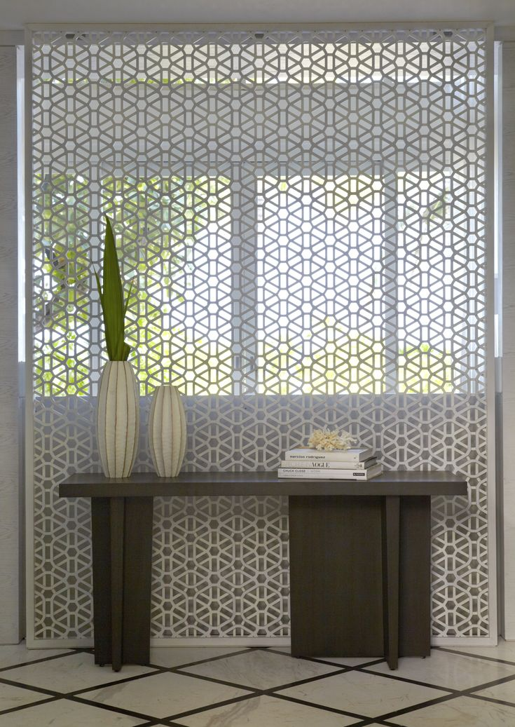 | P | Yabu Pushelberg's intricate white screen in the entry at Viceroy Maldives