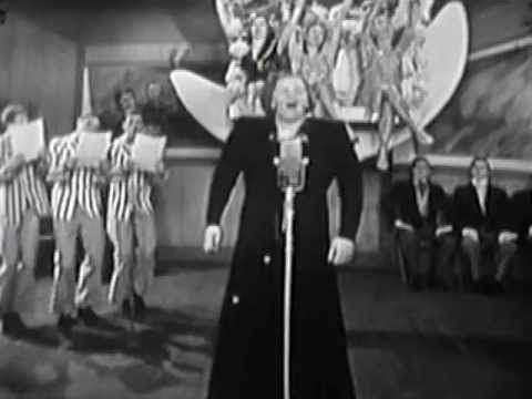 "The Kate Smith Hour: ""When the Moon Comes Over the Mountain"" is a popular song, published in 1931, and credited as written by Howard Johnson, Harry M. Woods, and Kate Smith."
