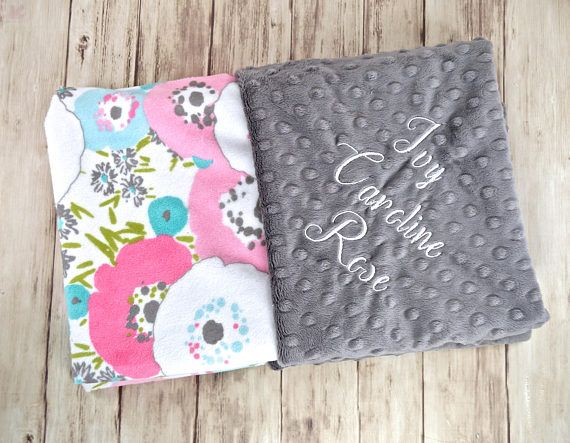 This listing is for 1 Minky Baby Blanket: Pink, Teal Gray and Aqua Floral print minky on one side and Charcoal Gray Minky Dot on the other. .  This blanket is approx. 29 x 35. It is Perfect for a crib, car seat or stroller. Blankets are zigzag topstitched to increase stability and wear. Each blanket comes wrapped in a satin ribbon with a tag containing care instructions. ***You have the option to PERSONALIZE the time of purchase. At checkout, please leave the following info in the notes to…