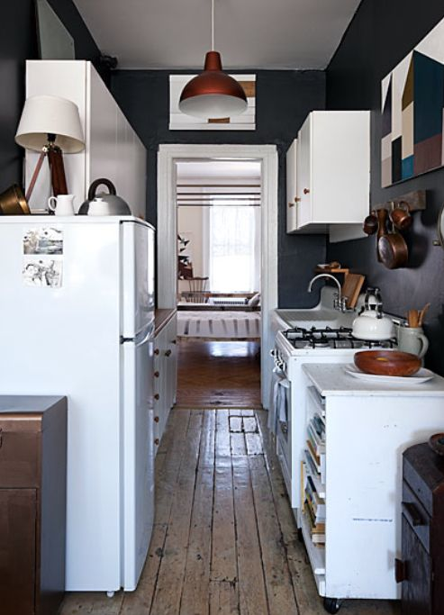 #vintage #small #kitchen with #dark_walls and #white_cabinets
