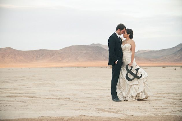 Love the incorporation of the ampersand in this wedding portrait. Cute idea. Photo by Megan Small.